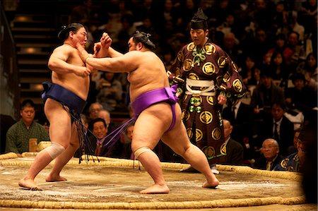 Asian men wrestling