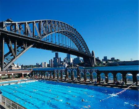 Swimming pool with bridge Stock Photos - Page 1 : Masterfile