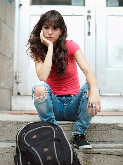 Teenage girl sitting on stairs Stock Photo - Premium Rights-Managed, Artist: Photononstop, Image code: 877-06833952