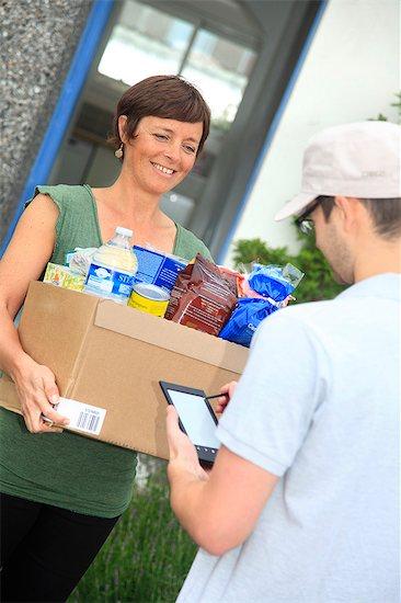 France, deliveryman at main door. Stock Photo - Premium Rights-Managed, Artist: Photononstop, Image code: 877-07460404